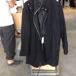 A. OK Black Wool Coat. Now: $200. Was: $400.
