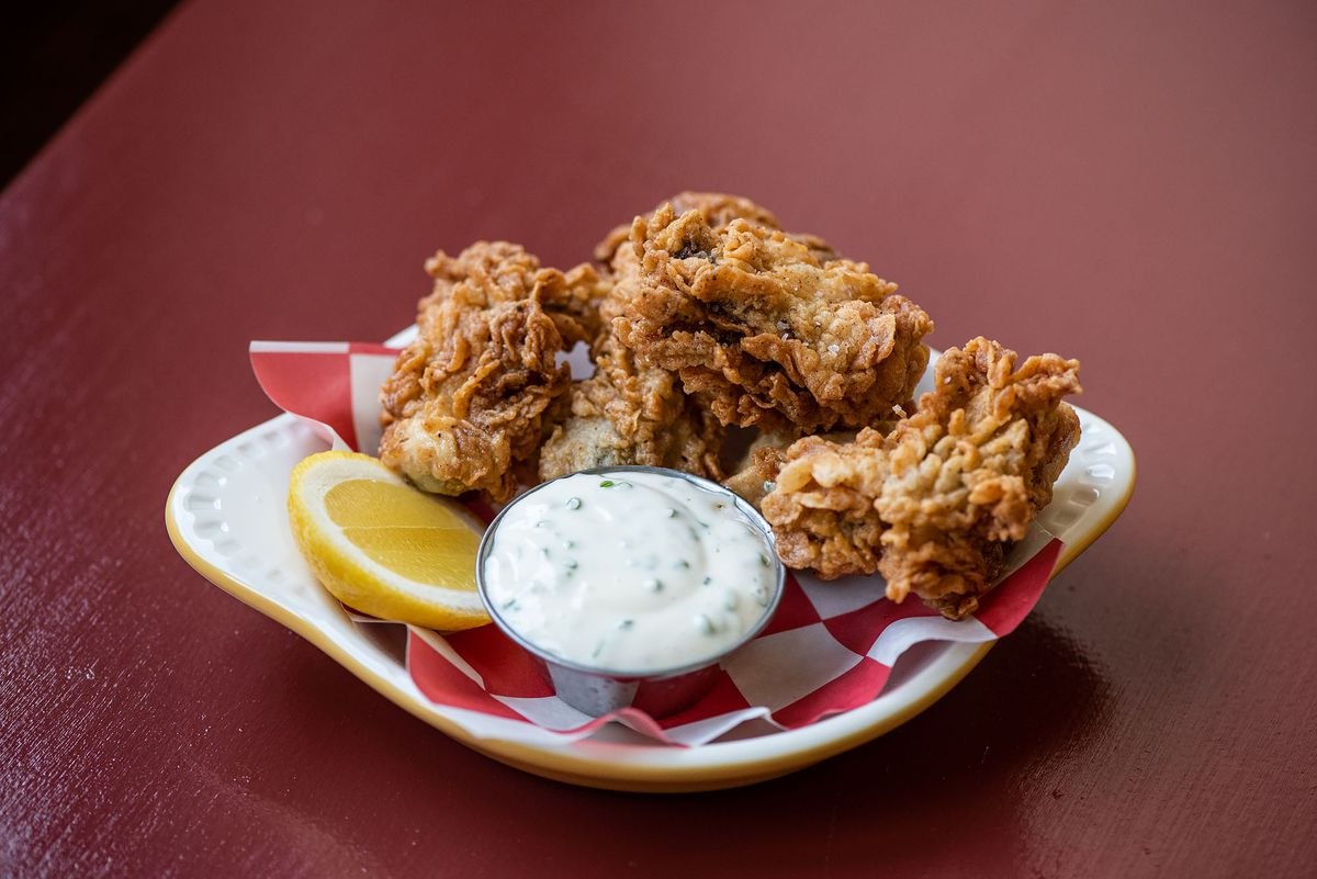 Fried oysters with tartar sauce on a plate at Found Oyster.