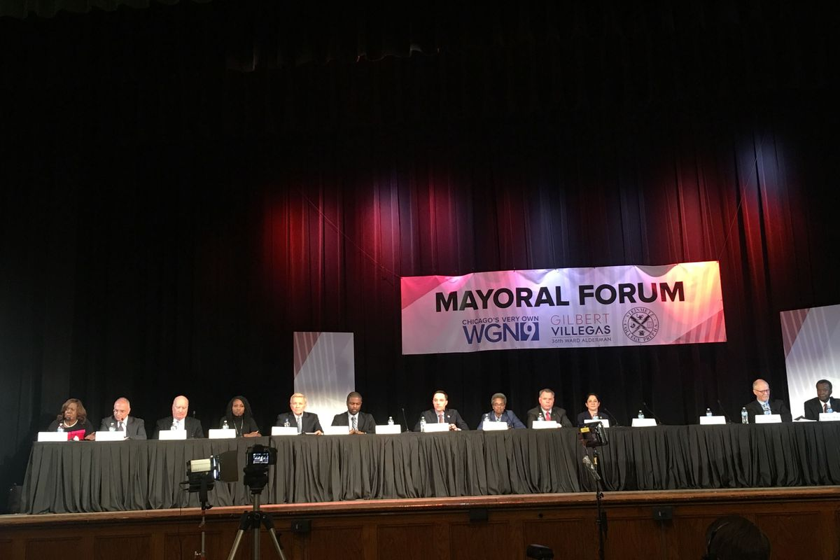 Mayoral candidates face off at Steinmetz High School during a candidate's forum.