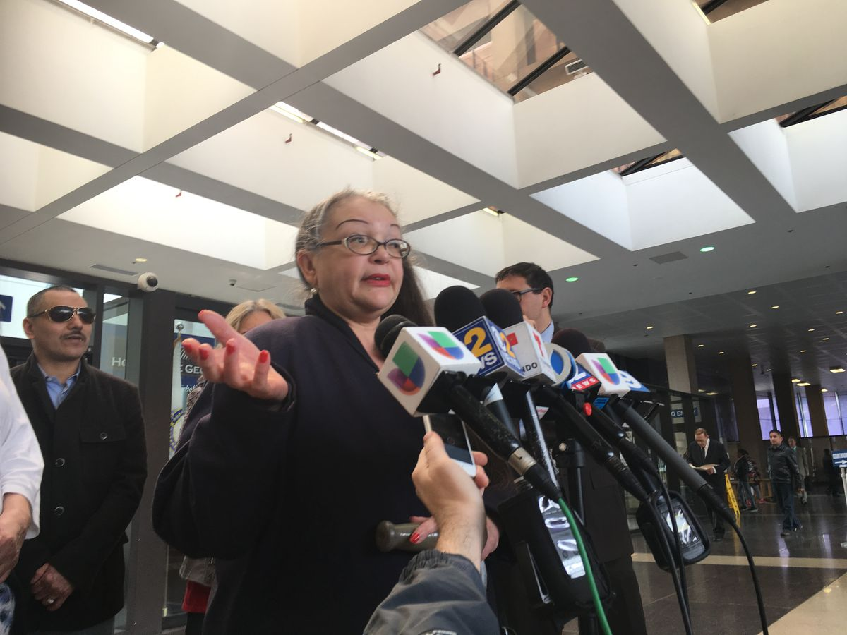Angela Navarro talks to reporters at the Leighton Criminal Courthouse on Friday after a hearing vacating her son Roberto Almodovar's conviction in a 1994 double murder case. | Andy Grimm/Sun-Times
