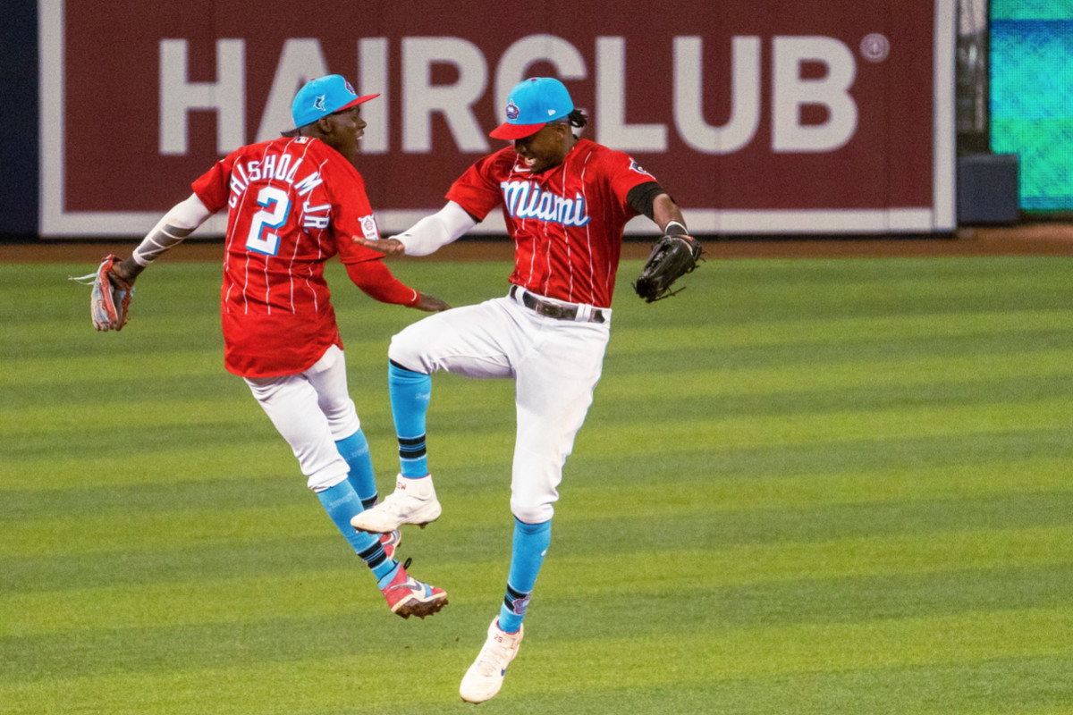 Jazz Chisholm Jr. and Lewis Brinson celebrate a Marlins win over the Phillies on September 4, 2021
