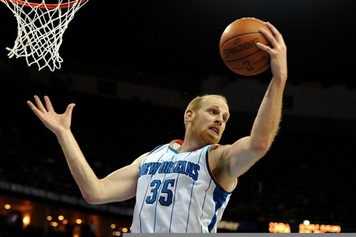 Mar 12, 2012; New Orleans, LA, USA; New Orleans Hornets center Chris Kaman (35) grabs a rebound in the second half of their game against the Charlotte Bobcats at the New Orleans Arena. The Bobcats won, 73-71. Mandatory Credit: Chuck Cook-US PRESSWIRE