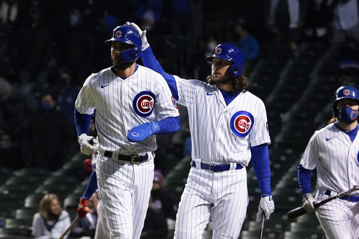 Chicago Cubs third baseman Kris Bryant is greeted by Chicago Cubs center fielder Jake Marisnick after scoring against the New York Mets during the fourth inning at Wrigley Field.