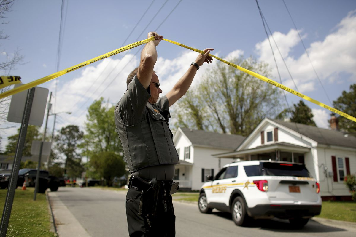 Law enforcement investigate the scene of a shooting, Wednesday, April 21, 2021 in Elizabeth City, N.C. At least one law enforcement officer with a sheriff's department in North Carolina shot and killed a man while executing a search warrant Wednesday, the sheriff's office said.