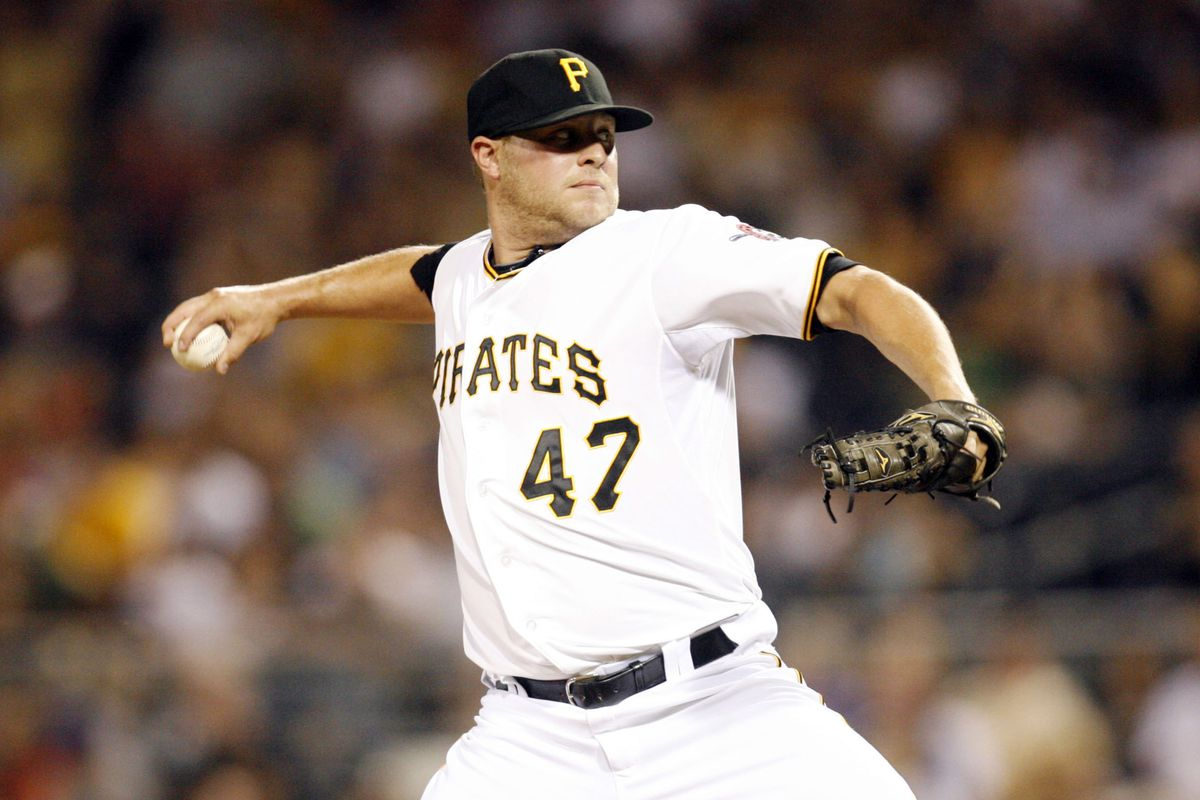 July 23, 2012; Pittsburgh, PA, USA; Pittsburgh Pirates relief pitcher Evan Meek (47) pitches against during the ninth inning at PNC Park. The Chicago Cubs won 2-0. Mandatory Credit: Charles LeClaire-US PRESSWIRE