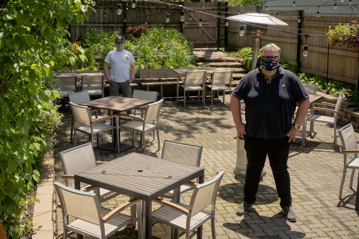 Kevin Hickey, owner of The Duck Inn, and Brian Phillips, the beverage partner of the restaurant, pose for a portrait on The Duck Inn's patio, which was set up to accomodate social distancing on May 24, 2020. | Pat Nabong/Sun-Times
