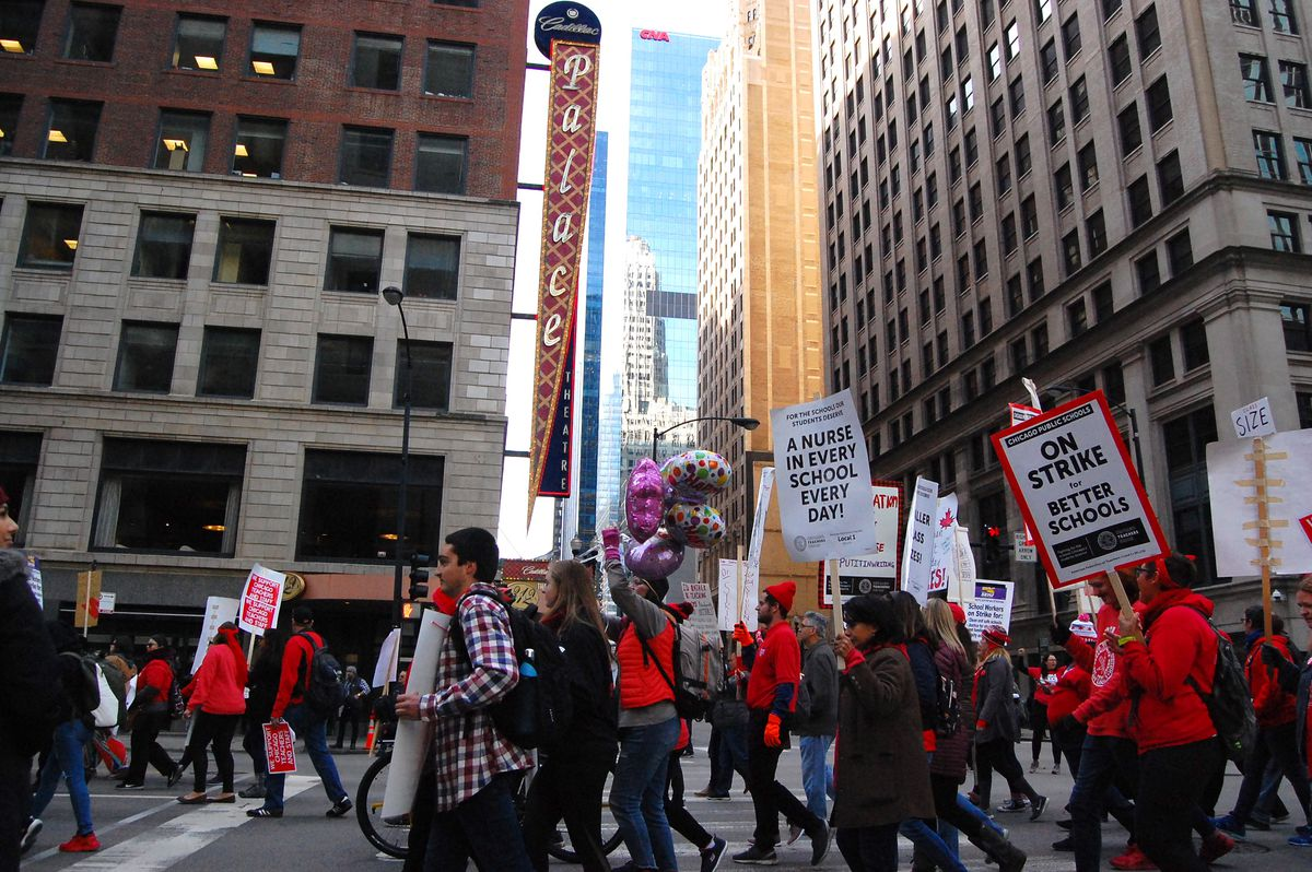 Chicago Teachers Union members rally in downtown Chicago during an 11-day strike.