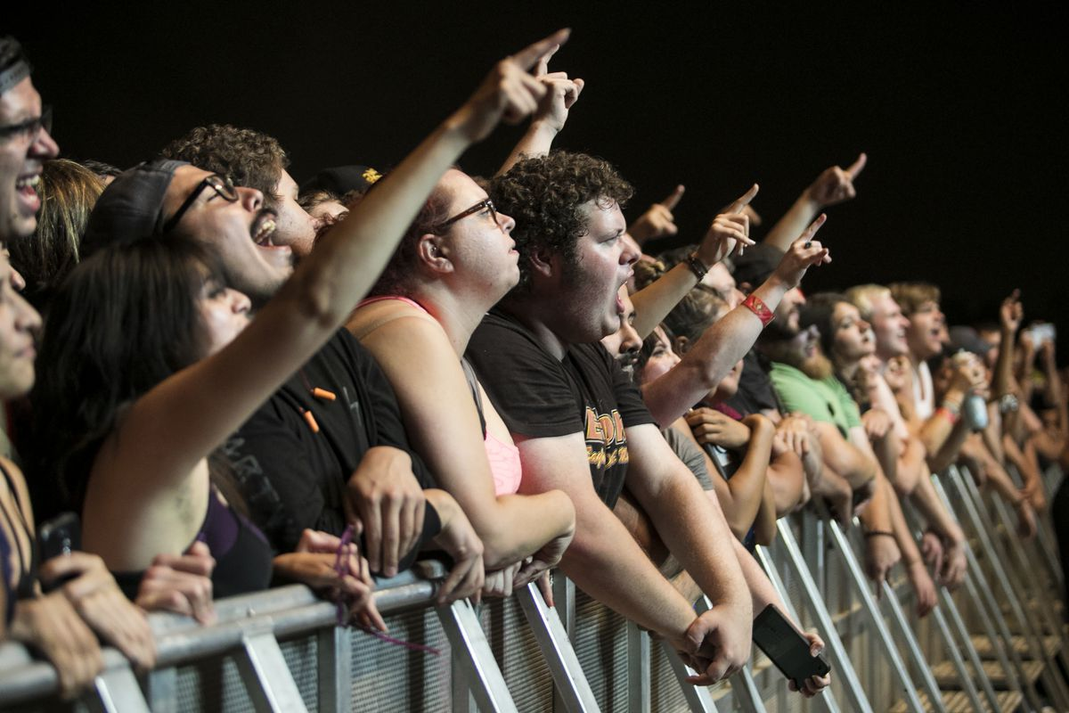 Fans cheer as Queens of the Stone Age performs on day two of Riot Fest in Douglas Park, Sept. 16, 2017. | Ashlee Rezin/Sun-Times