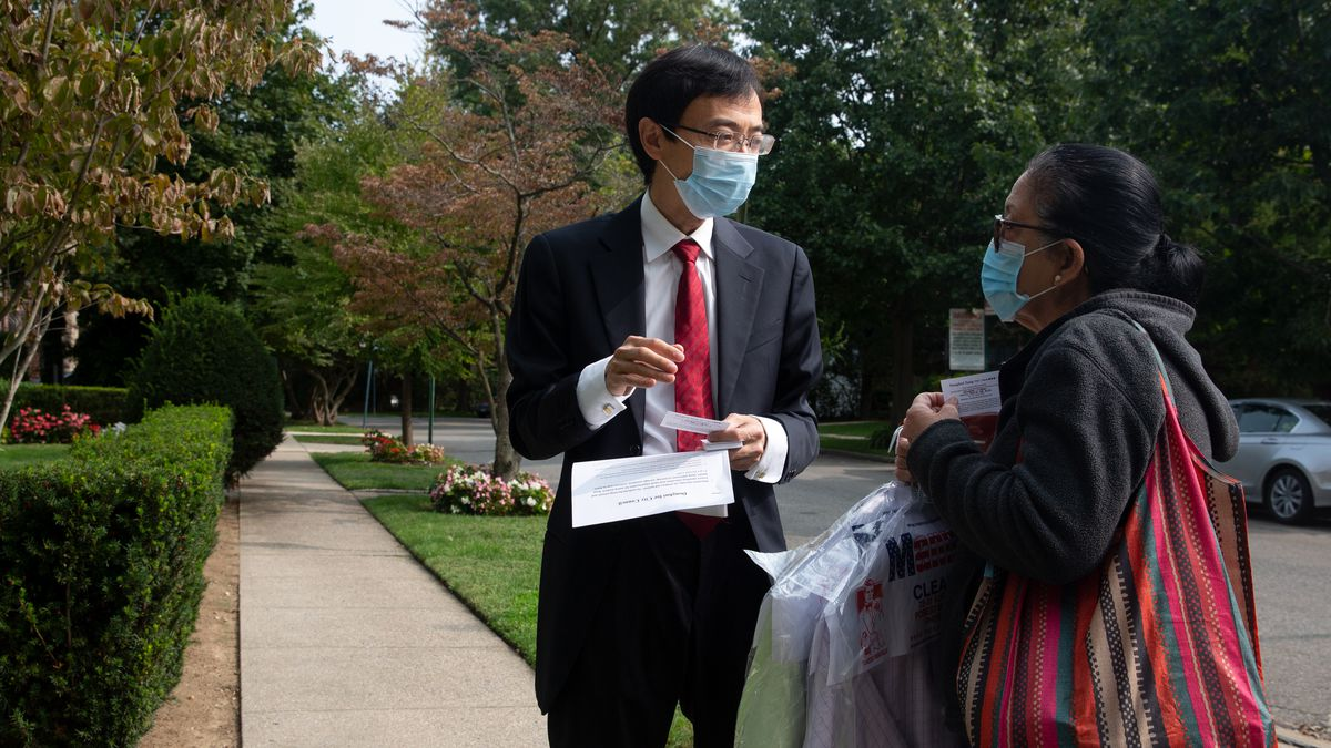 Donghui Zang campaigns for City Council near his Forest Hills, Queens home, Sept. 15, 2020.