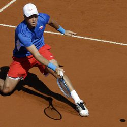 Czech Republic's Tomas Berdych returns the ball to Argentina's Carlos Berlocq during the Davis Cup semifinals tennis match in Buenos Aires, Argentina on Sunday, Sept. 16, 2012.