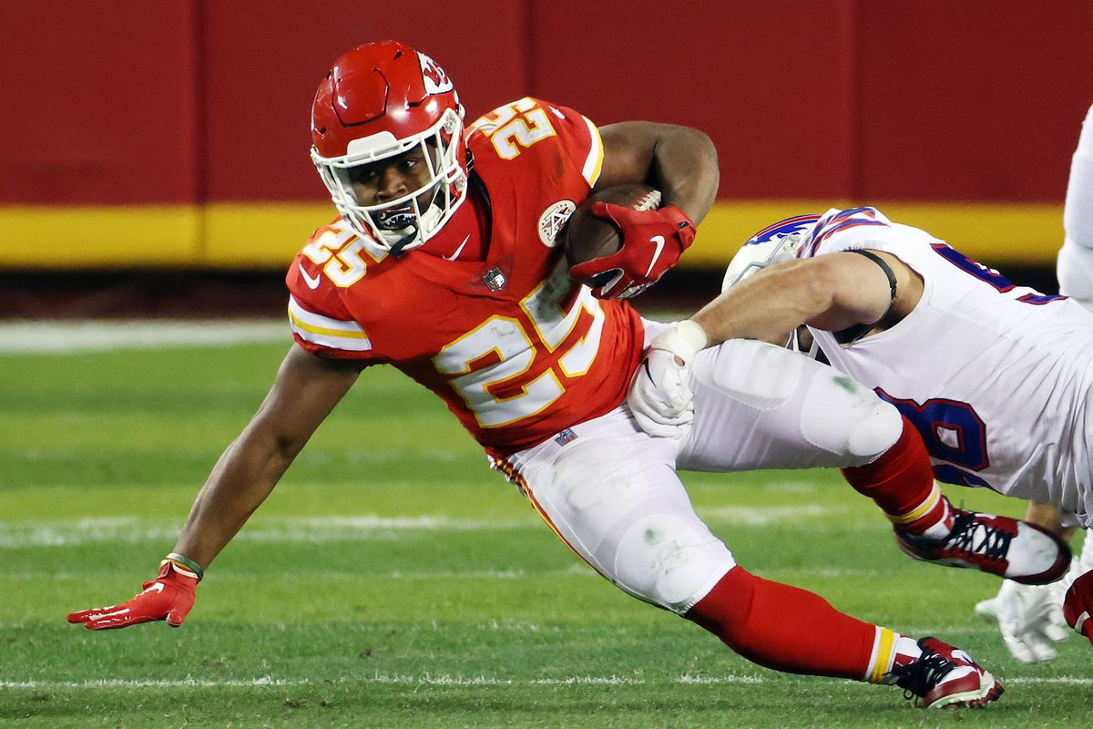 Clyde Edwards-Helaire #25 of the Kansas City Chiefs is tackled by Matt Milano #58 of the Buffalo Bills in the first half during the AFC Championship game at Arrowhead Stadium on January 24, 2021 in Kansas City, Missouri.