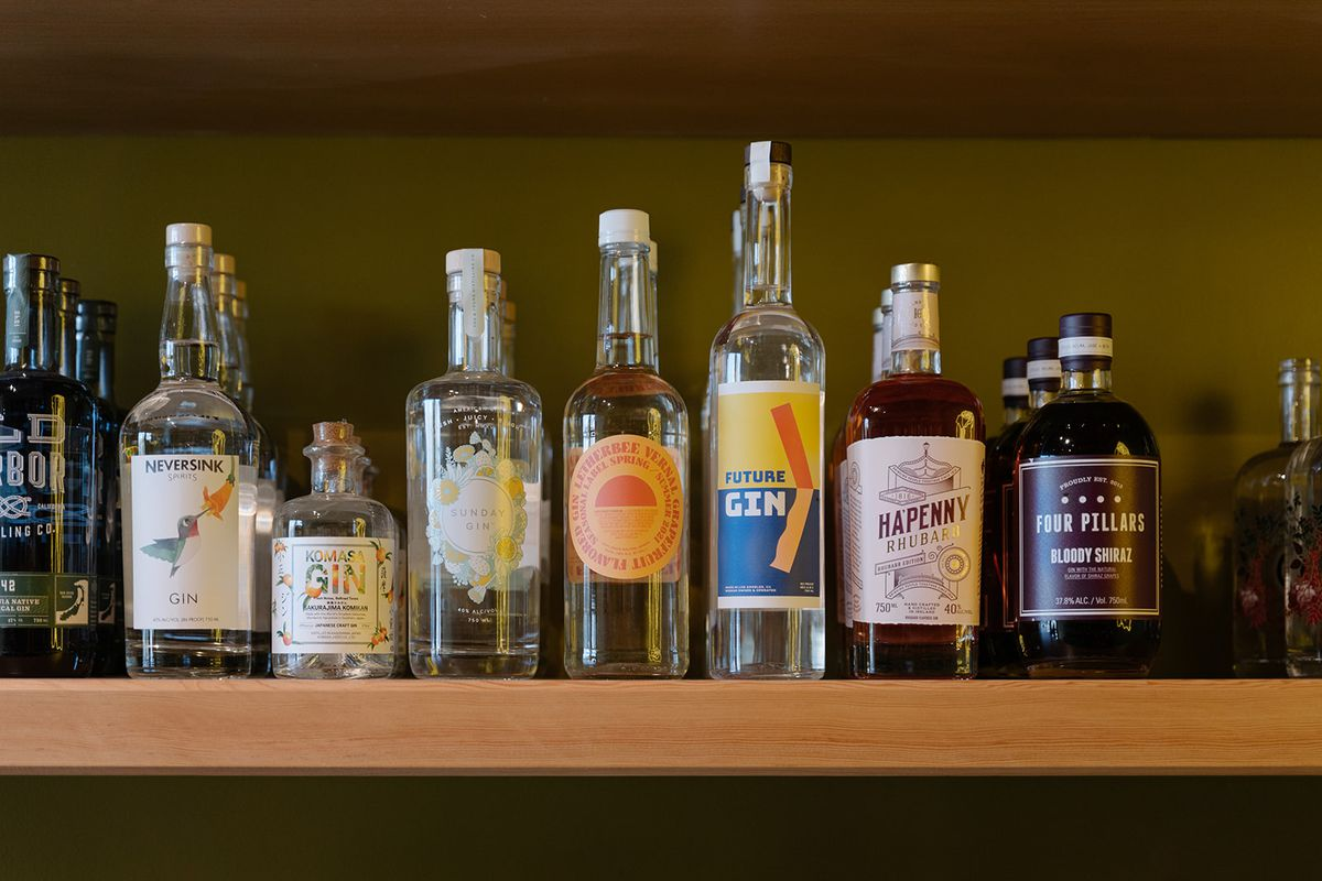 A collection of gin bottles on the shelf at Bodega Rosette.