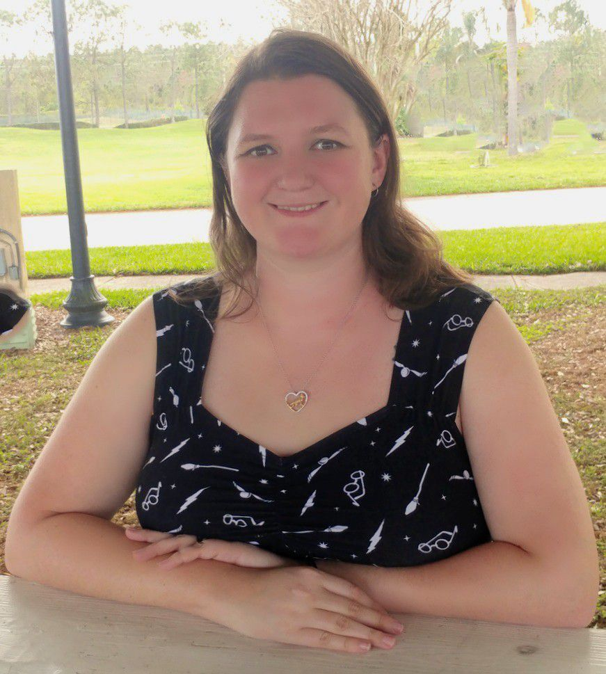 Academic and behavior support teacher Megan Prince is seated outside in Polk County, Florida.