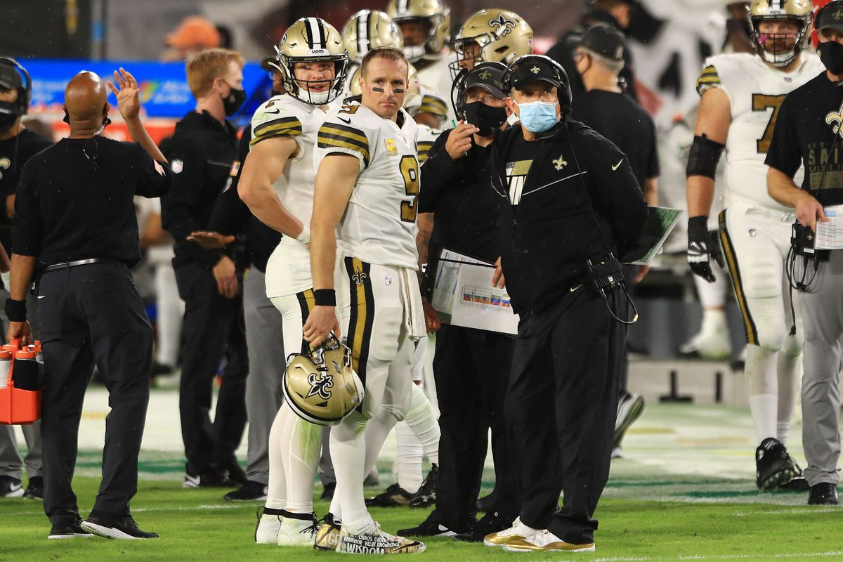 Drew Brees #9 of the New Orleans Saints talks with head coach Sean Payton during the first half against the Tampa Bay Buccaneers at Raymond James Stadium on November 08, 2020 in Tampa, Florida.
