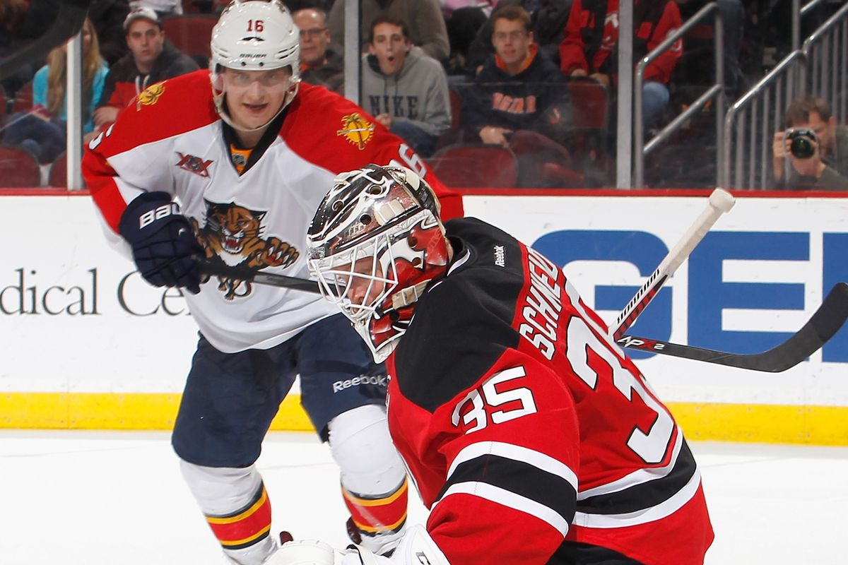 Cory Schneider makes one of his 29 saves.