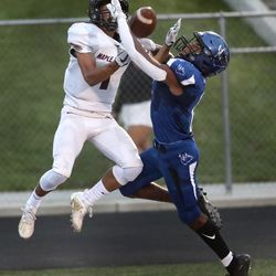 Maple Mountain wide receiver Kyson Hall makes a leaping catch for a touchdown over Pleasant Grove defender Aaron Jones during a football game at Pleasant Grove High School in Pleasant Grove on Friday, Aug. 21, 2020.
