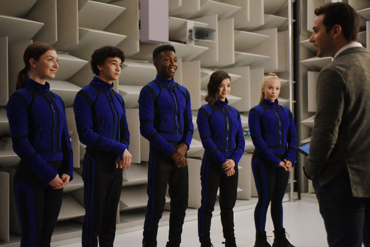 the five recruits looking at Professor Morrow while in uniform