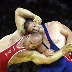 Rulon Gardner wrestles Alexander Karelin, three-time Olympic champ, in the Greco-Roman heavyweight wrestling finals at the 2000 Olympics in Sydney.