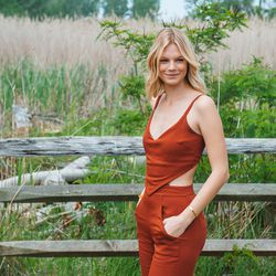 Model Nadine Leopold let the cutouts of her jumpsuit be the focus, and kept the rest of her look simple.
