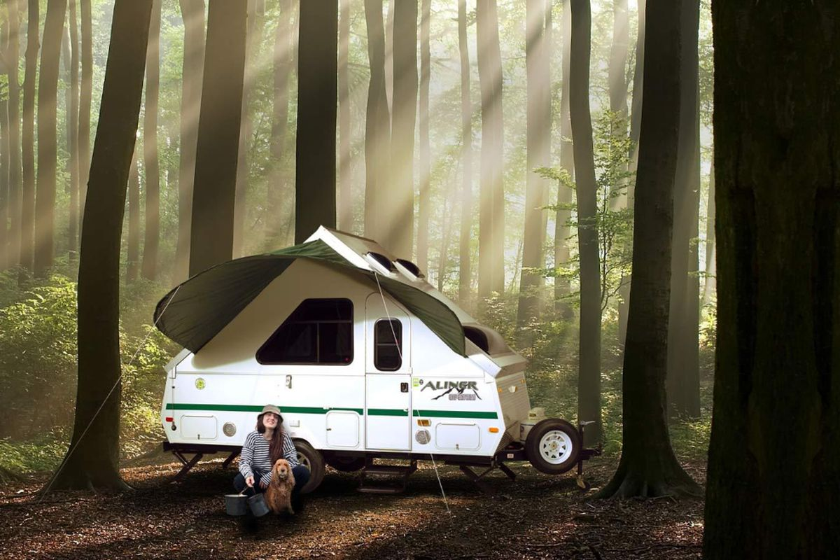 An Aliner Camper In A Forest Courtesy Of