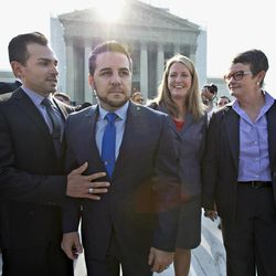 Arriving at the Supreme Court in Washington, Wednesday, June 26, 2013, on a final day for decisions in two gay marriage cases are plaintiffs in the California Proposition 8 case, from left, Paul Katami, his partner Jeff Zarrillo, and Sandy Stier and her partner Kris Perry.
