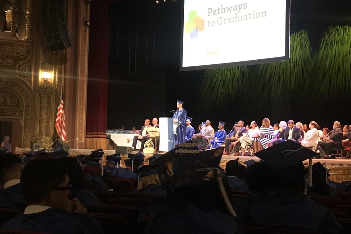 A student speaks to a crowd of graduates during the 2019 Pathways to Graduation ceremony in Harlem.