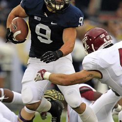 Penn State running back Michael Zordich (9) runs with the ball as Temple defensive back Justin Gildea (4) closes in to make the tackle during the first quarter of an NCAA college football game in State College, Pa., Saturday, Sept. 22, 2012. Penn State won 24-13.