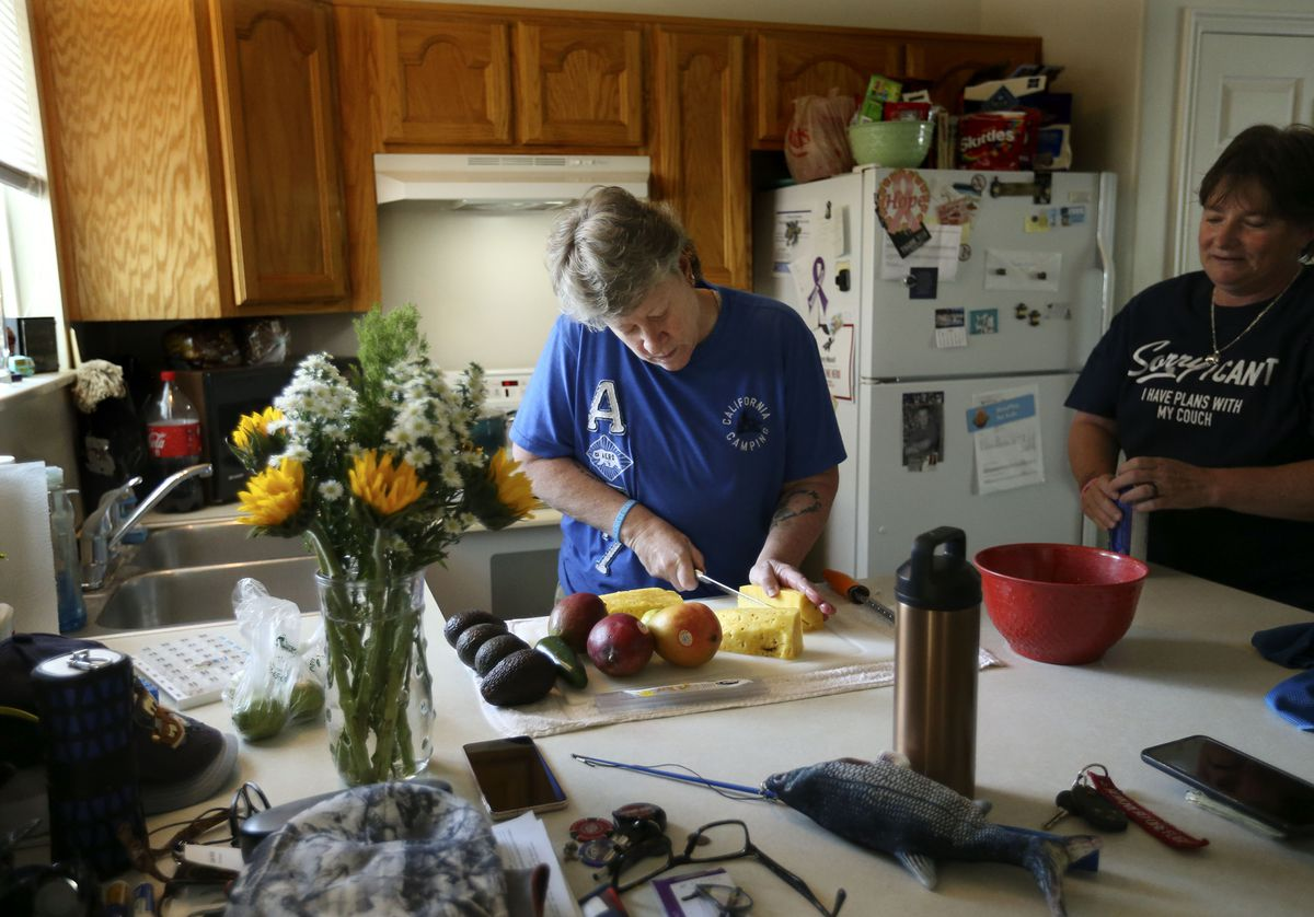 Susan Munsell-Beck and Sherry Munsell prepare dinner at their Clinton home on Tuesday, June 15, 2021. Munsell-Beck is a chef and Munsell is a truck driver. When Munsell and her wife first moved into a three-bedroom, two-bathroom house in Clinton about three years ago, their rent cost $1,345. Now, it costs about $1,550 a month, including insurance.