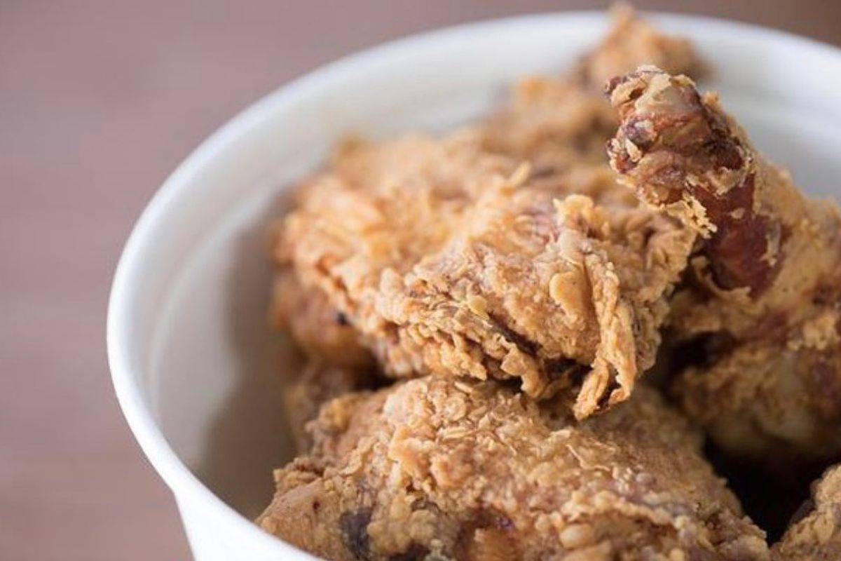 A bucket of pieces of bone-in fried chicken