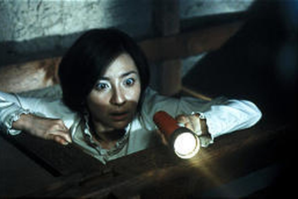"""Megumi Okina plays Rika, a student nurse who comes face-to-face with some murderous spirits in """"Ju-on: The Grudge."""""""