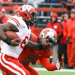 Runningback Corey Clement stiff arms a Rutgers Defender on his way to a touchdown.