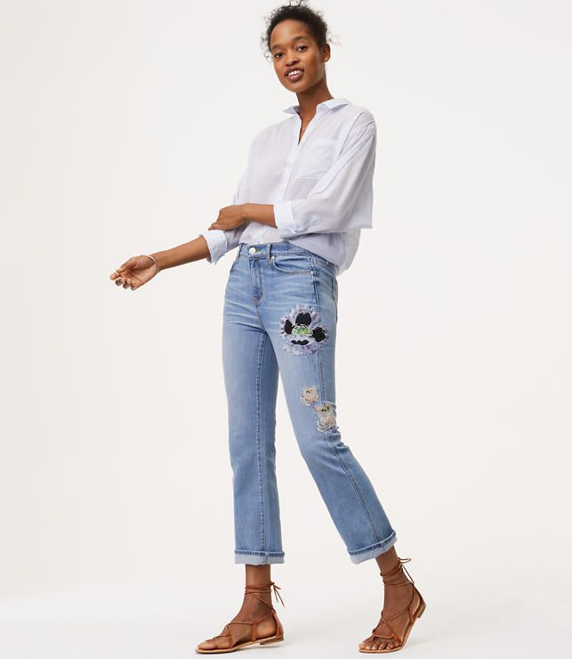 model in embroidered jeans