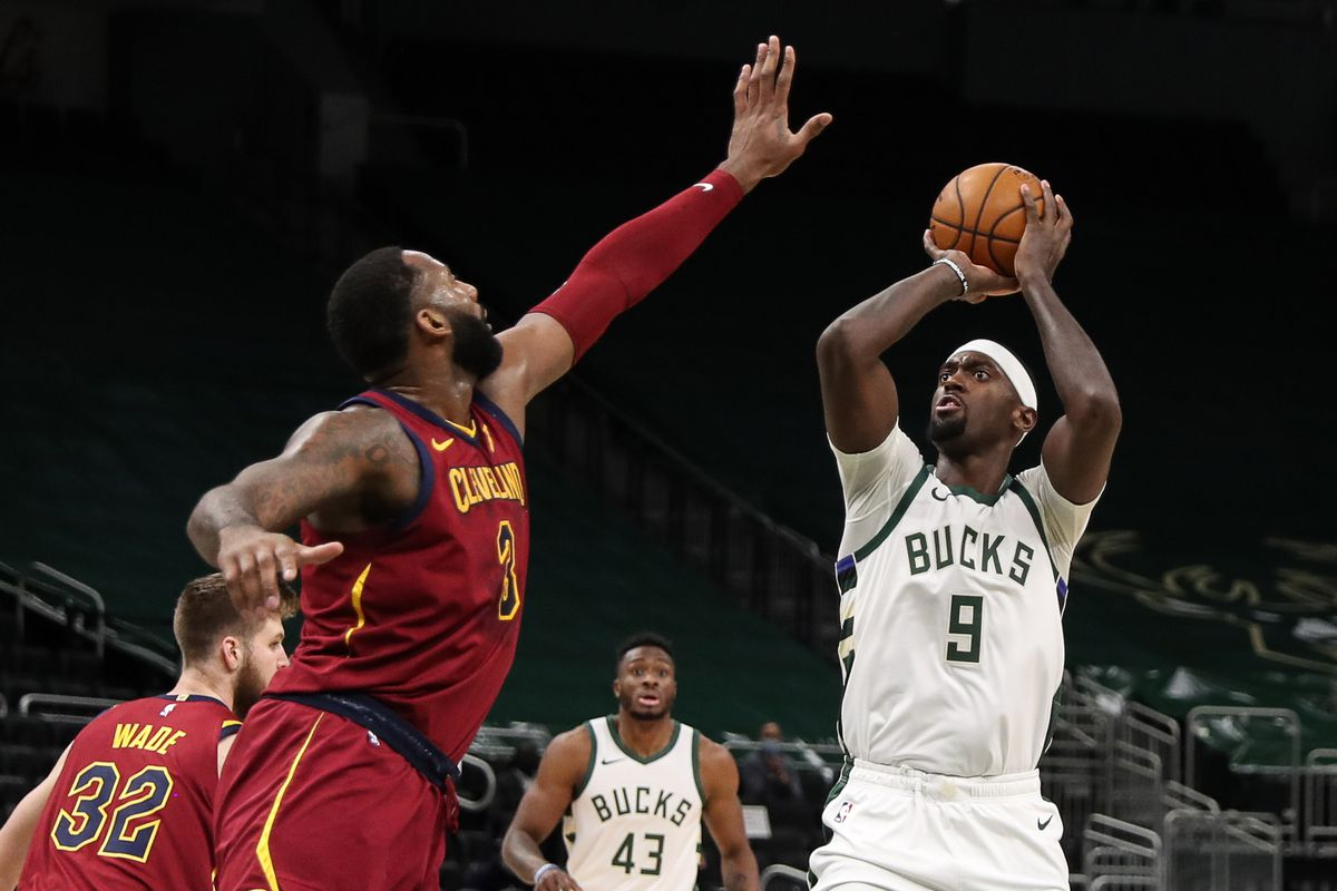 Milwaukee Bucks forward Bobby Portis (9) shoots against Cleveland Cavaliers center Andre Drummond (3) at the Bradley Center.