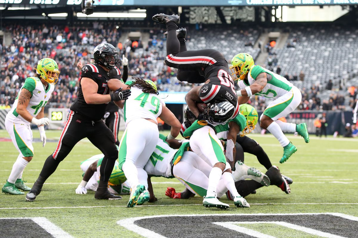 New York Guardians running back Tim Cook III dives into the end zone to complete a one point attempt against the Tampa Bay Vipers on February 9, 2020 at MetLife Stadium in East Rutherford, New Jersey.