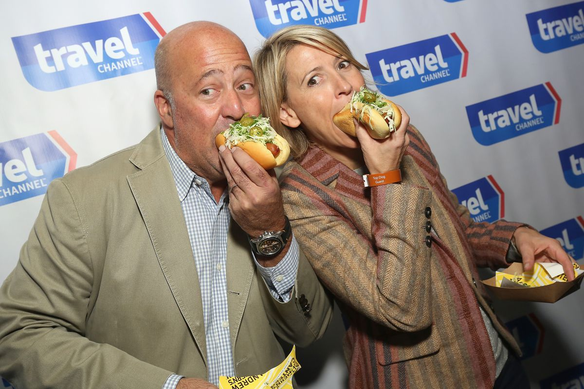 Travel Channel hosts Andrew Zimmern and Samantha Brown are not eating sandwiches in this photograph.