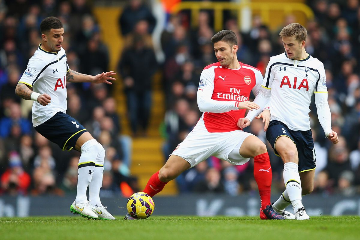Two Spurs players trying to learn from a better player. Photo