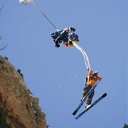 Jesse Hall opens his chute after jumping off a ski ramp at the top of cliffs in Echo Canyon.