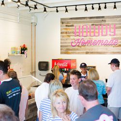 Customers select their ice cream flavors during the grand opening of Howdy Homemade Ice Cream in Salt Lake City, which opened Sept. 2, 2017.