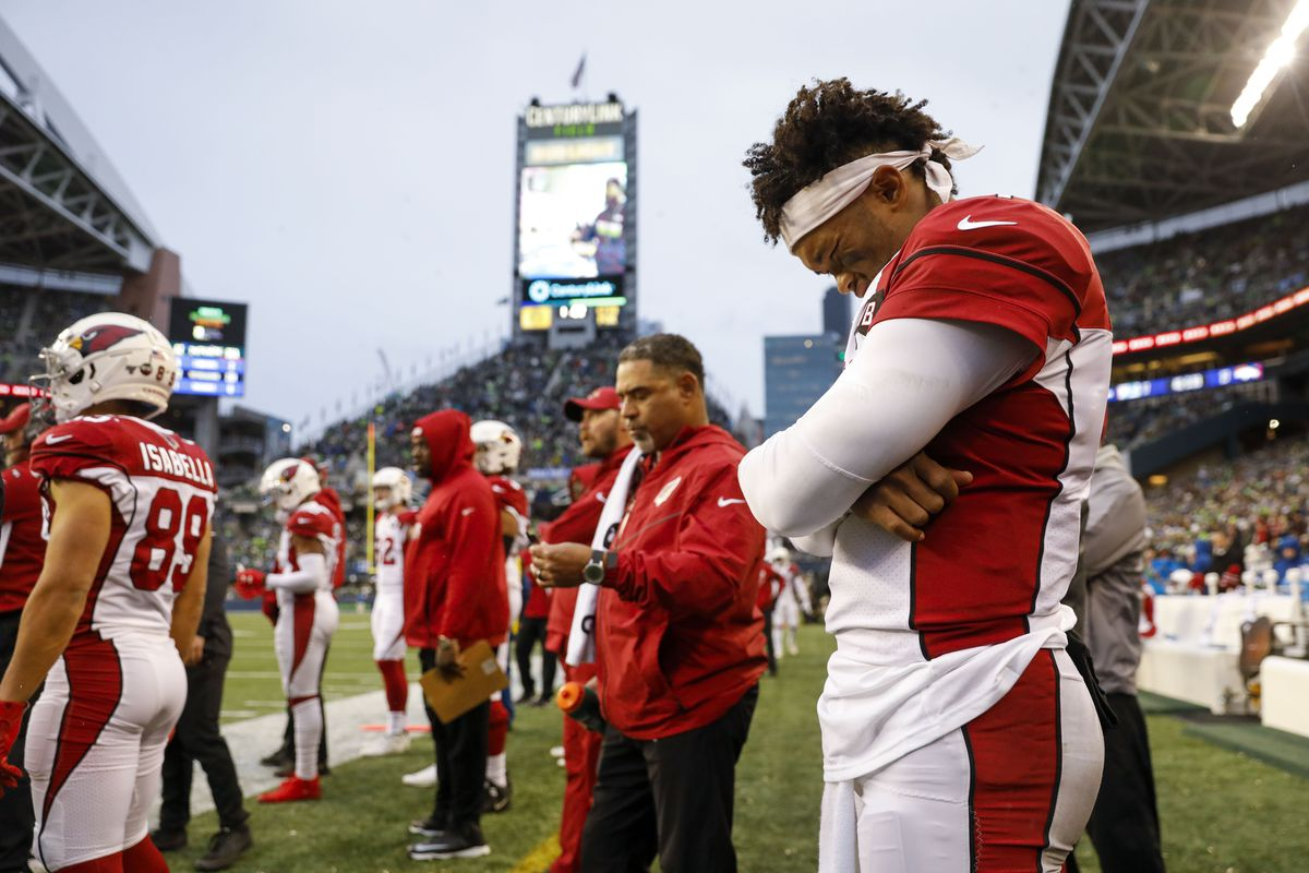 Arizona Cardinals quarterback Kyler Murray stands on the sideline following a third quarter injury against the Seattle Seahawks at CenturyLink Field.