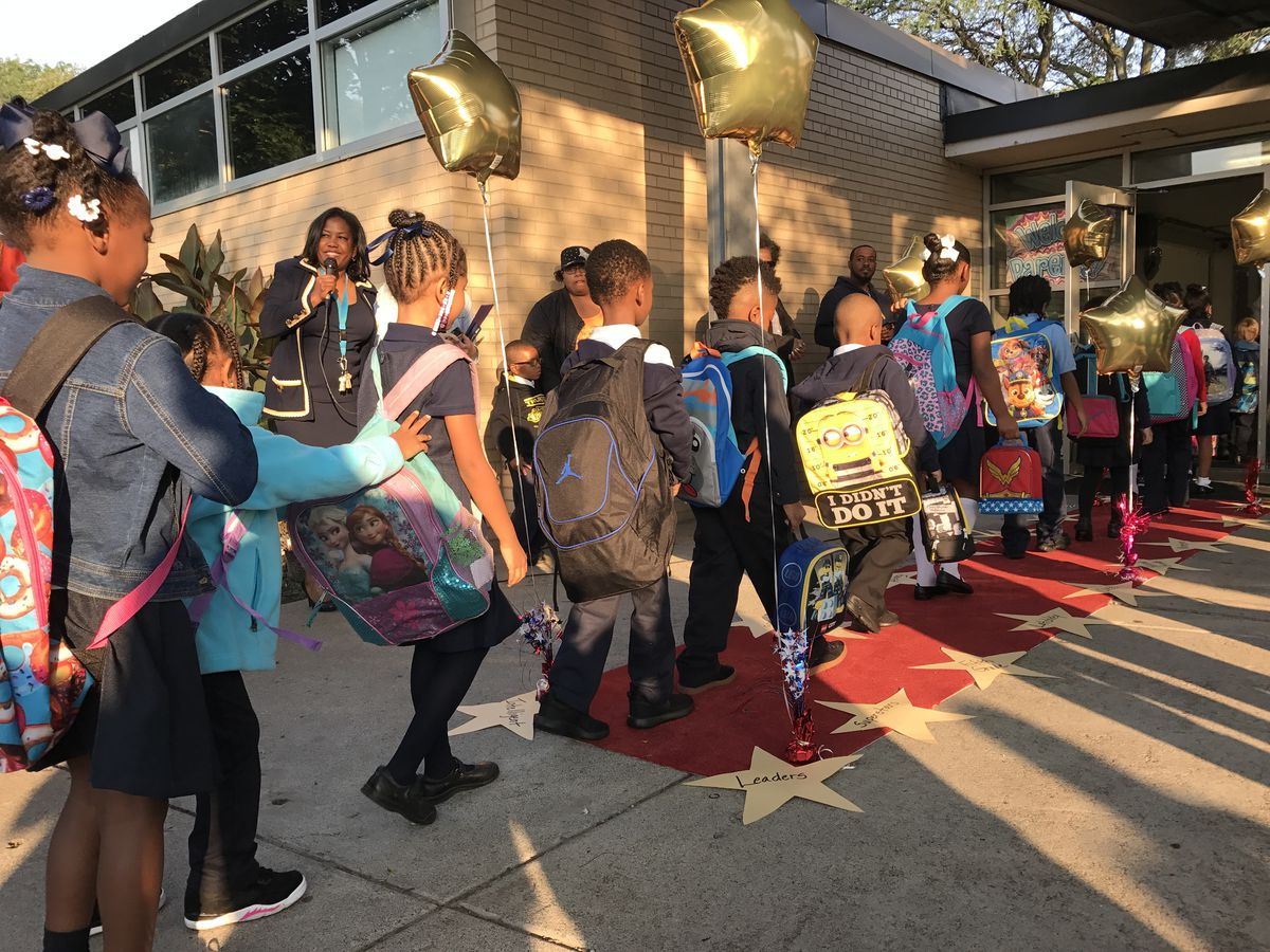 Not all district schools faced challenges on the first day. Students at Detroit's Chrysler elementary school walked the red carpet the school set up for the first day of school.