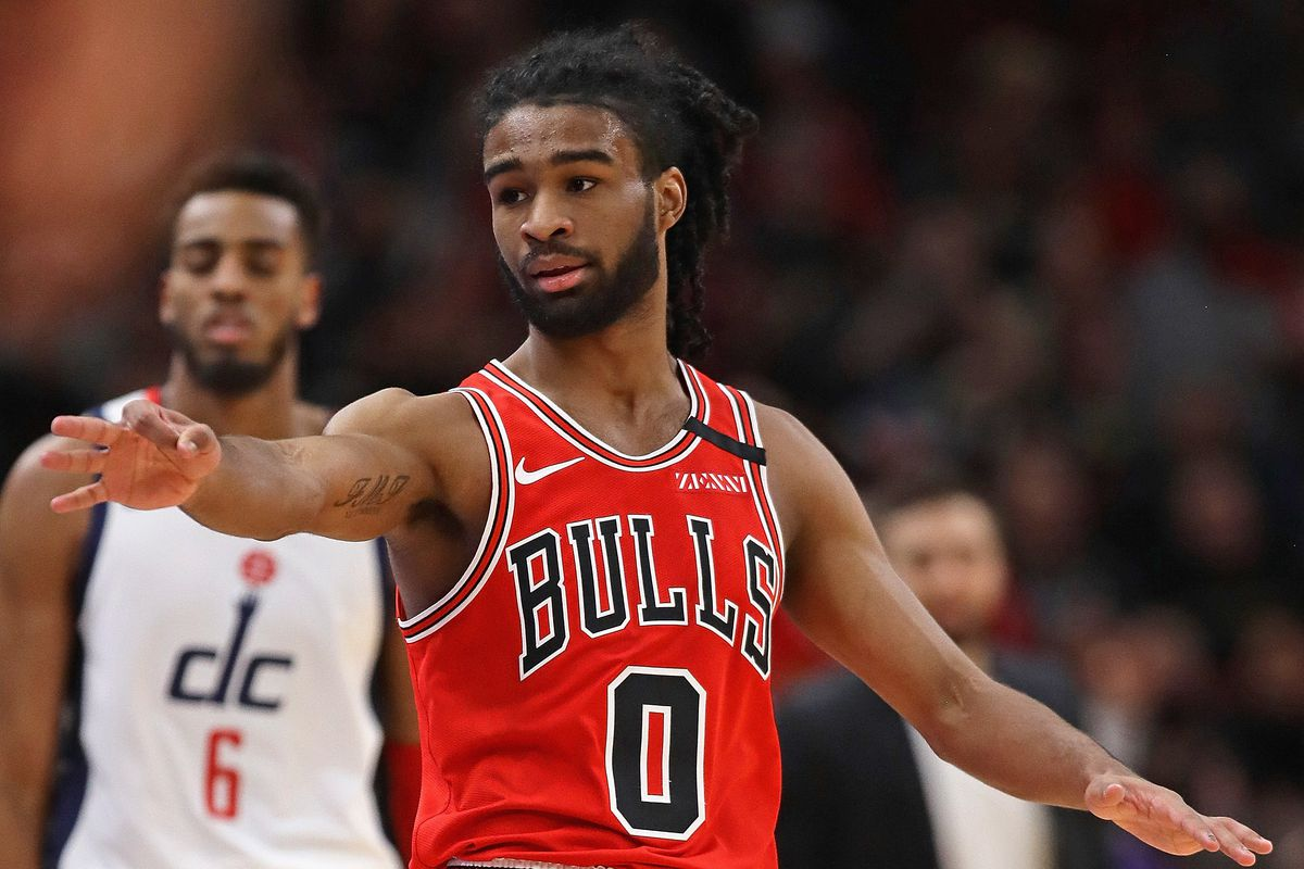 The Bulls' Coby White holds out three fingers after hitting a three-point shot against the Wizards Sunday at the United Center.