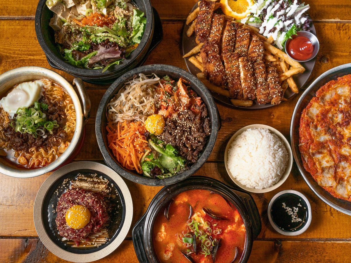 table covered in korean dishes