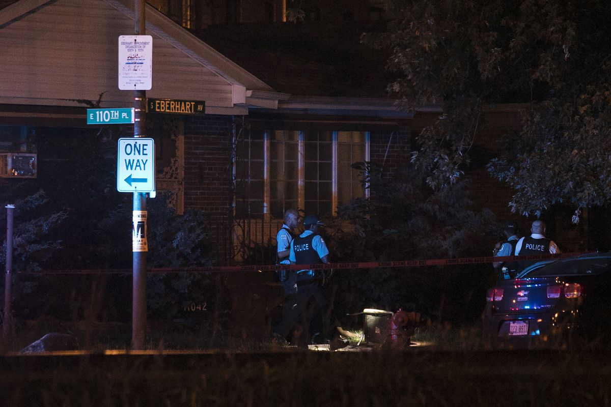 Chicago Police investigate near 110th Place and Eberhart Avenue, where two men were killed and two others were wounded in a shooting early Wednesday, July 5, 2017. | Ashlee Rezin/Sun-Times