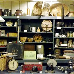 Some Pioneer Memorial Museum exhibits recreate entire rooms. This example presents now-antique items that might have been found in a ZCMI Zions Cooperative Mercantile Institution store during the era.