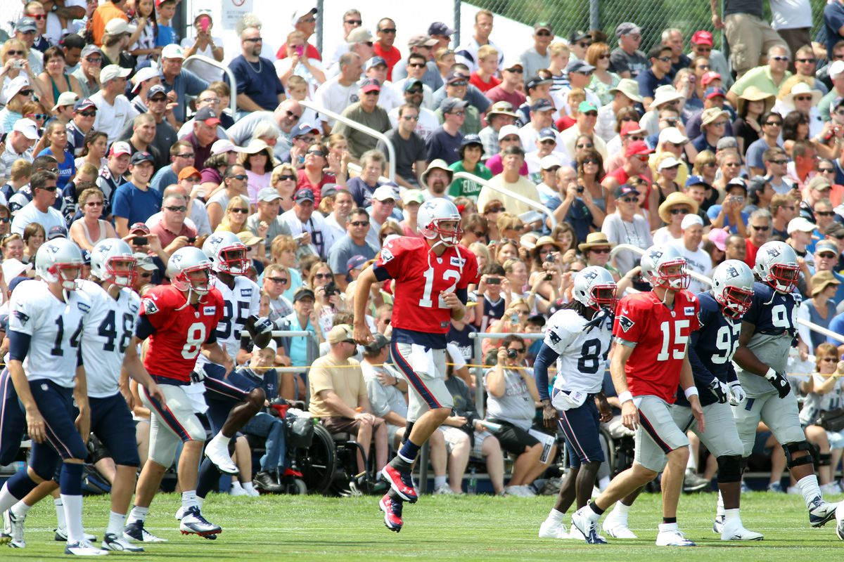 Aug 7, 2012; Foxborough, MA, USA; New England Patriots quarterback Tom Brady (12) warms up during a joint practice with the New Orleans Saints at the teams practice facility. Mandatory Credit: Stew Milne-US PRESSWIRE