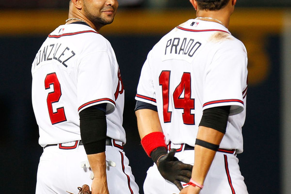 ATLANTA - JULY 15:  Alex Gonzalez #2 and Martin Prado #14 of the Atlanta Braves converse during a pitching change agianst the Milwaukee Brewers at Turner Field on July 15 2010 in Atlanta Georgia.  (Photo by Kevin C. Cox/Getty Images)