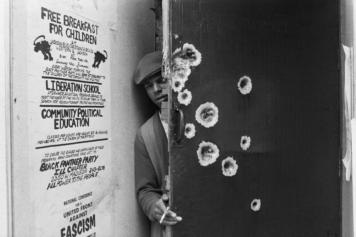 Black Panther Standing Behind Bullet-Riddled Door