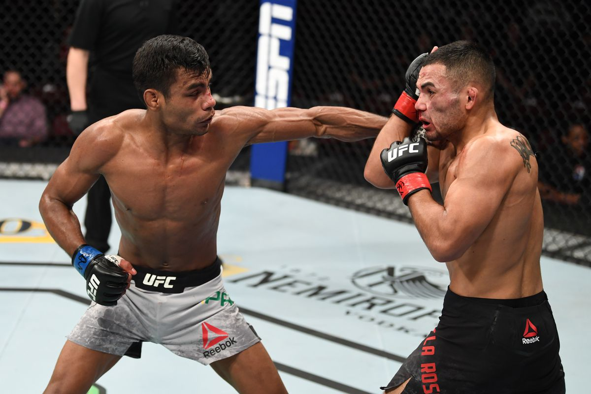 Raulian Paiva of Brazil punches Mark De La Rosa in their flyweight bout during the UFC Fight Night event at Santa Ana Star Center on February 15, 2020 in Rio Rancho, New Mexico.