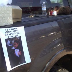 A flyer for missing 6-year-old Isabel Celis is placed on a volunteer's car in Tucson, Ariz., Sunday, April 22, 2012. Police cordoned off a neighborhood block where the girl went missing from her home during the night, as authorities fanned out Sunday over a wide area looking for clues to the possible kidnapping.