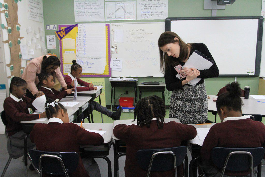 Erica Murphy, school director of Brownsville Ascend Lower Charter School, oversees students in a fourth-grade English class.